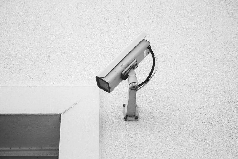 white security camera on white wall