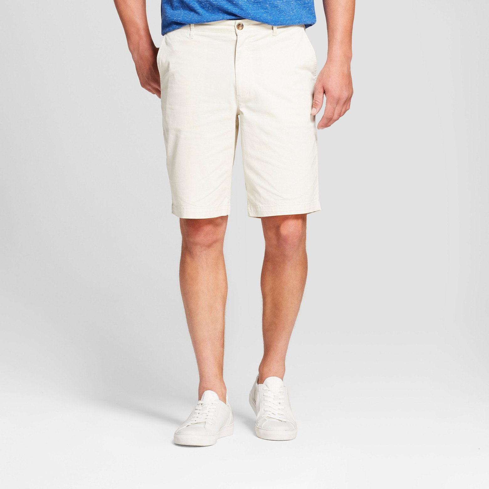 Person with blue shirt tucked into white khaki shorts  with white on.