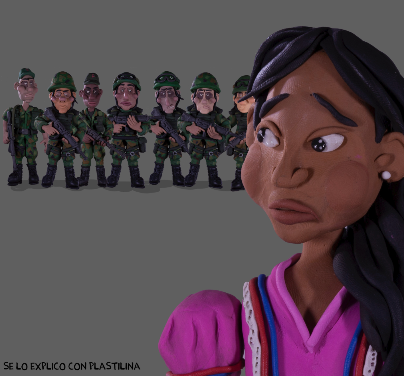 Clay model of a girl with black hair dressed in a purple shirt is  at the front right of the image. She is looking back warily at 7 male soldiers dressed in green camoflauge holding guns.