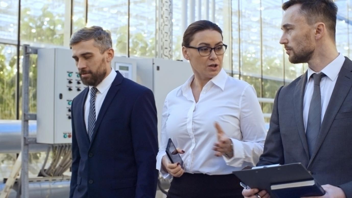 woman-talking-investors-greenhouse-complex-footage-090722652_prevstill.jpeg