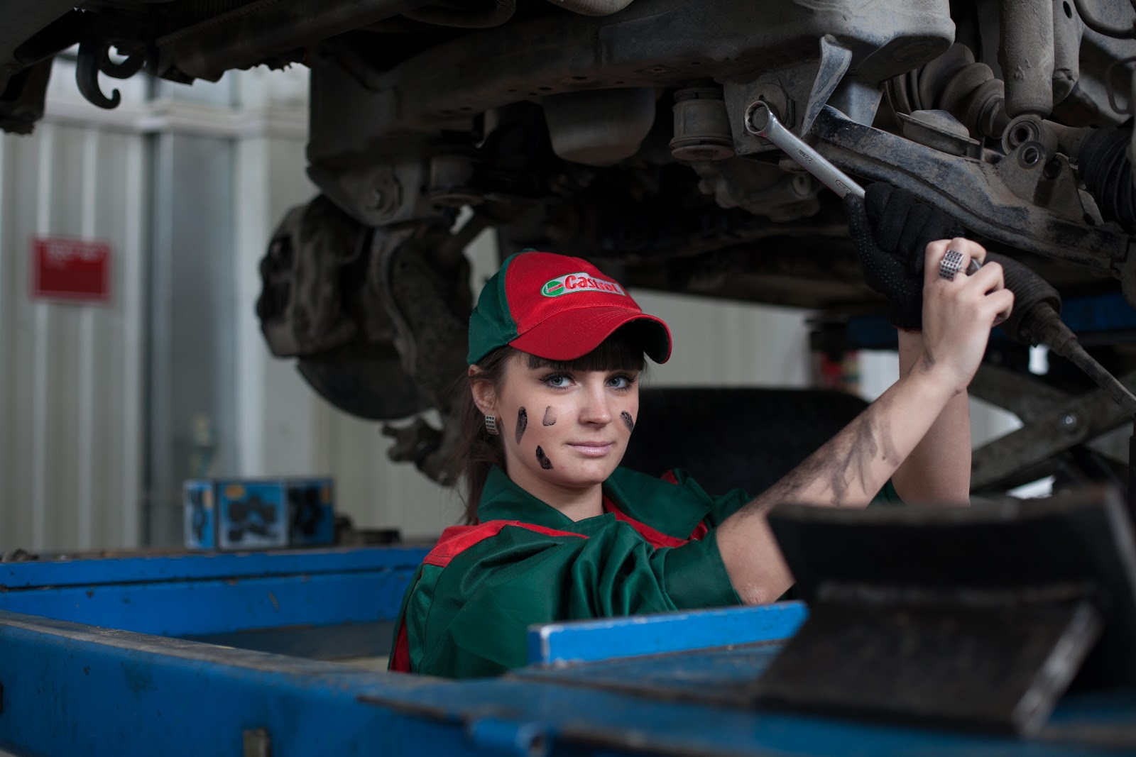 A woman works on a chassis