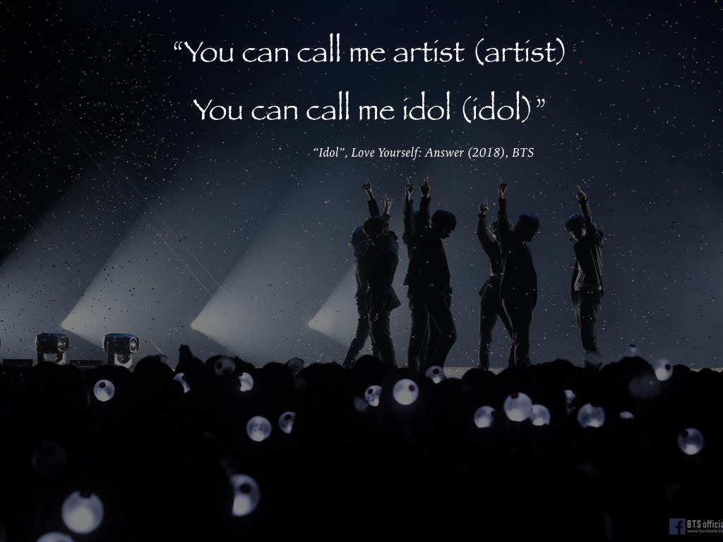 "BTS concert picture with lyrics of IDOL, ""You can call me artist (artist) , You can call me idol (idol)"""