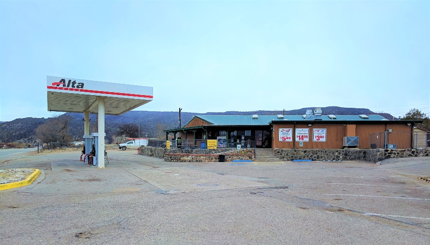 Photo of the Real Estate & Business for Sale at 1410 NM 68 in New Mexico. Shows gas station and front view of building.