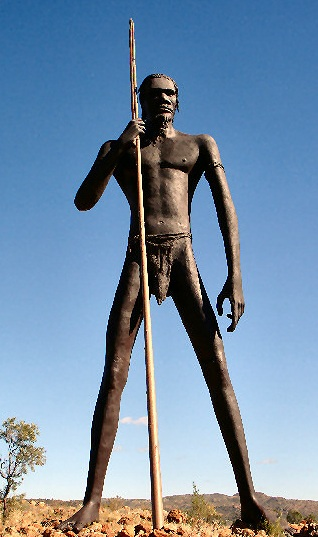The Big Aboriginal Hunter In Anmatjere - a giant sculpture of an aboriginal australia holding a spear