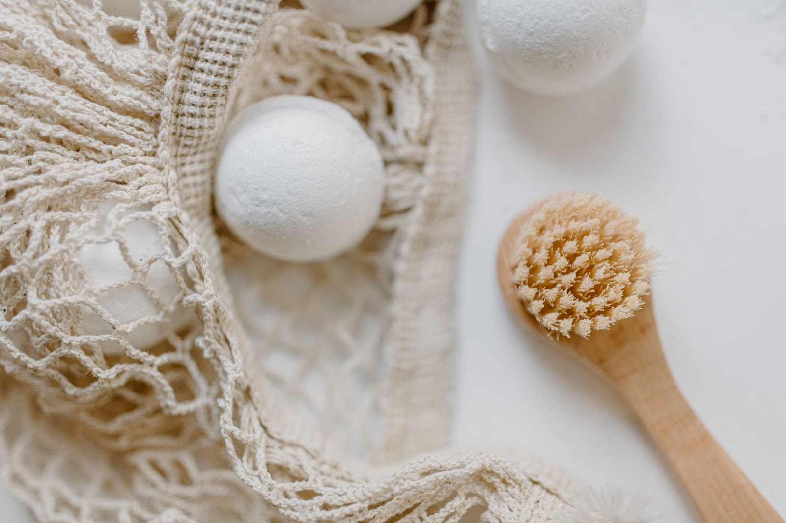 Close up of a bath bomb and a loofa. 'Self care' is one of the popular beauty & jewelry keywords on Etsy.