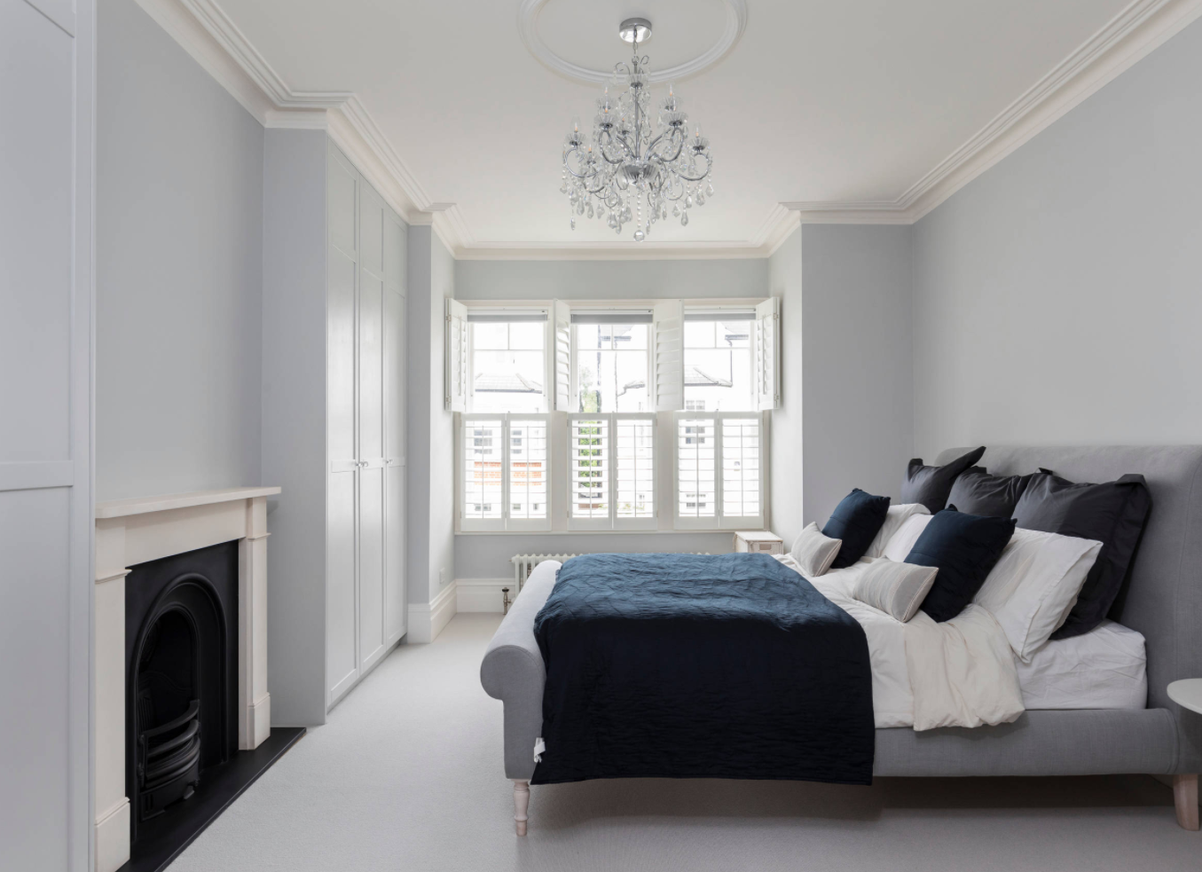 Bedroom inside Victorian townhouse in West London.
