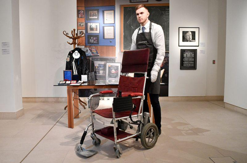 The motorised chair, used by Hawking after he was paralysed with motor neuron disease, raised 296,750 pounds in a Christie's online auction.