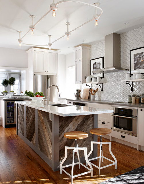 reclaimed wood island in a white kitchen with white backsplash and white marble countertop