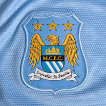 Man City home shirt 2013-2014 logo