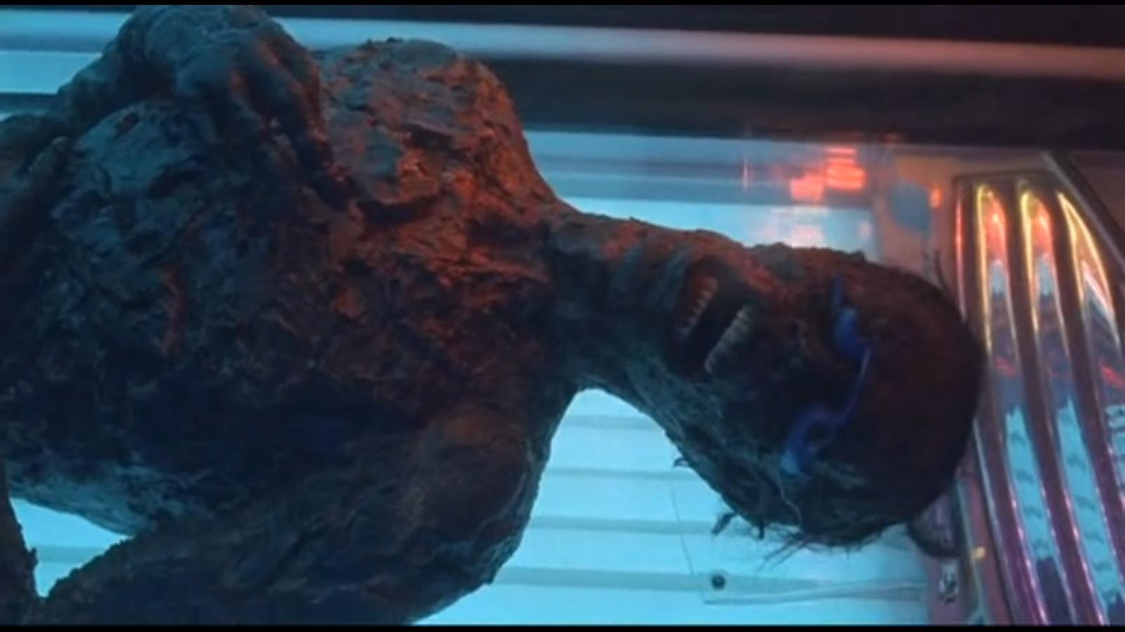 Urban Legend 3: Bloody Mary. A close up of a burnt and blackened corpse lying inside a tanning bed.
