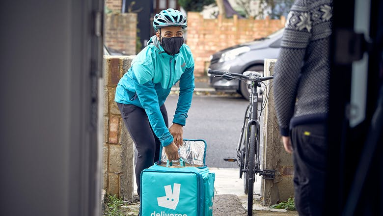 A Deliveroo rider with a mask working amidst the COVID-19 pandemic.