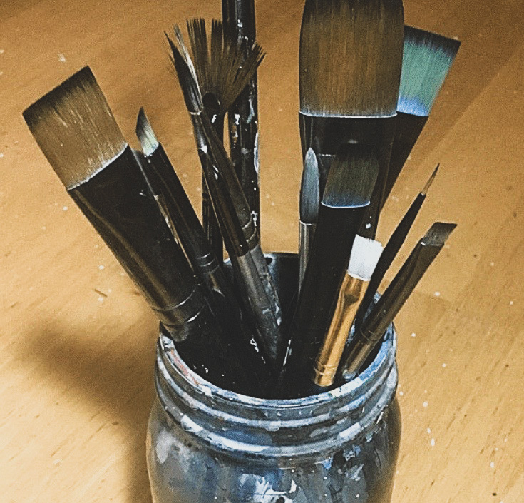 paint brushes in jar