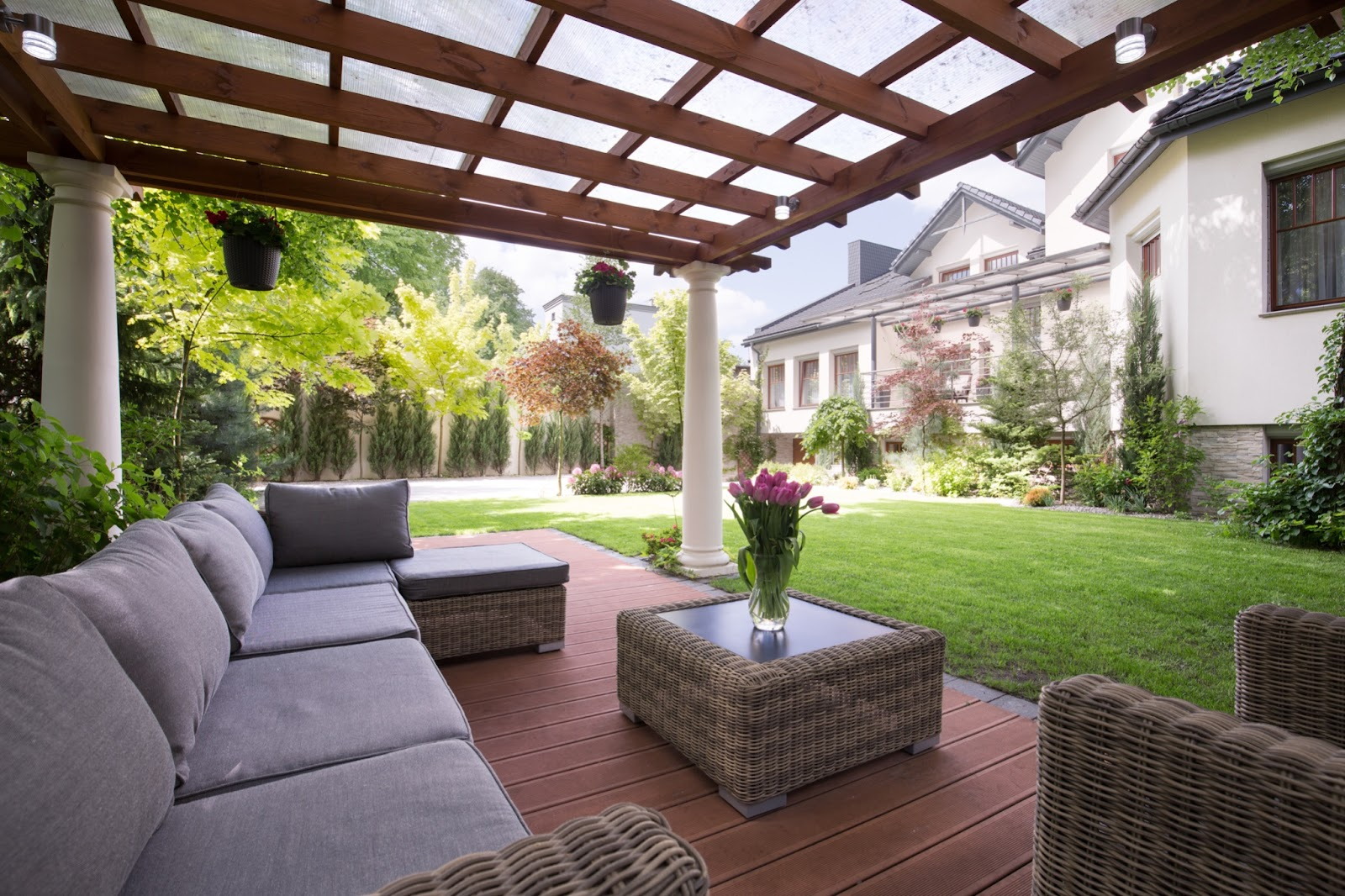 Luxury covered patio with view of house and yard