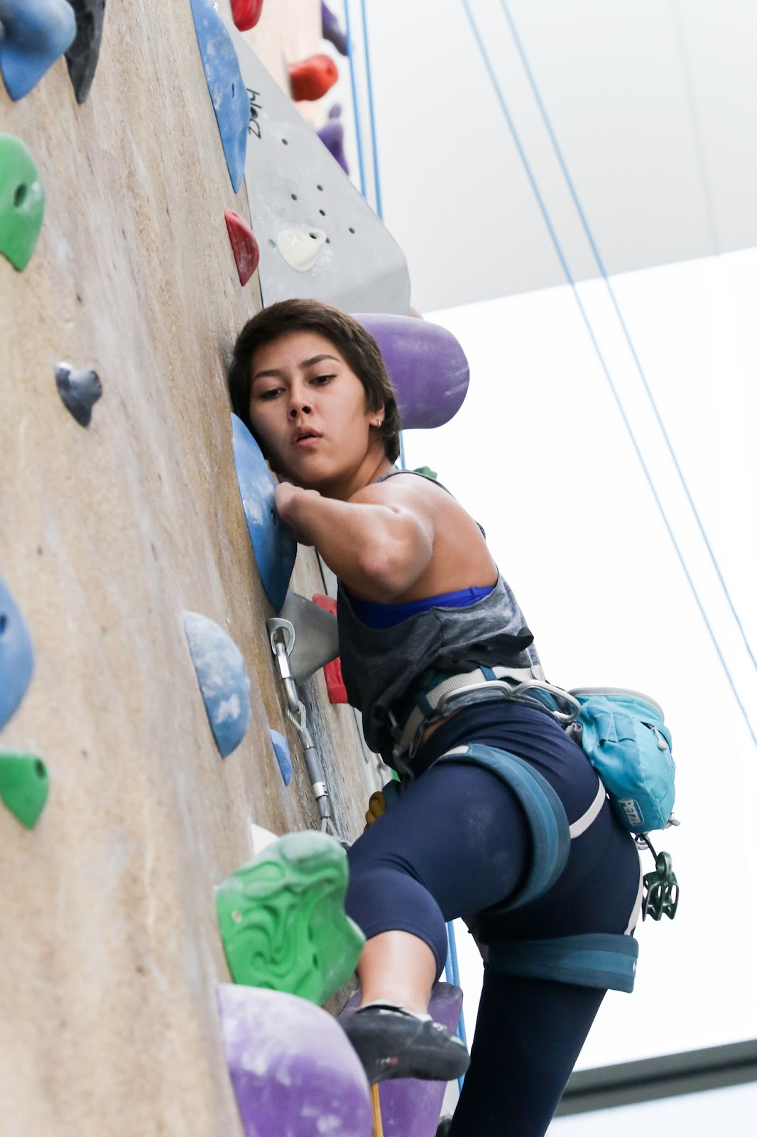 Photo of Christina focusing while climbing the BRIC's Bronco Peak