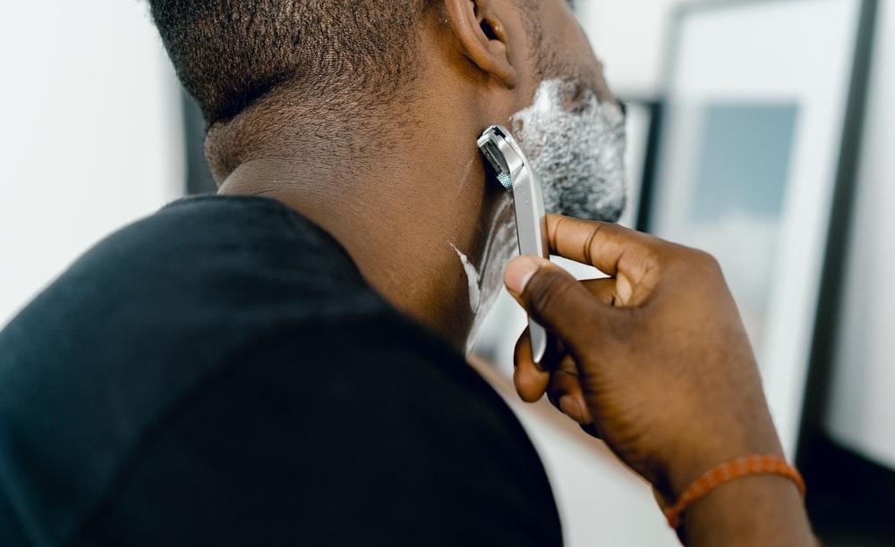 man shaving himself clean shave