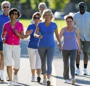 A group of people walking  Description automatically generated with low confidence