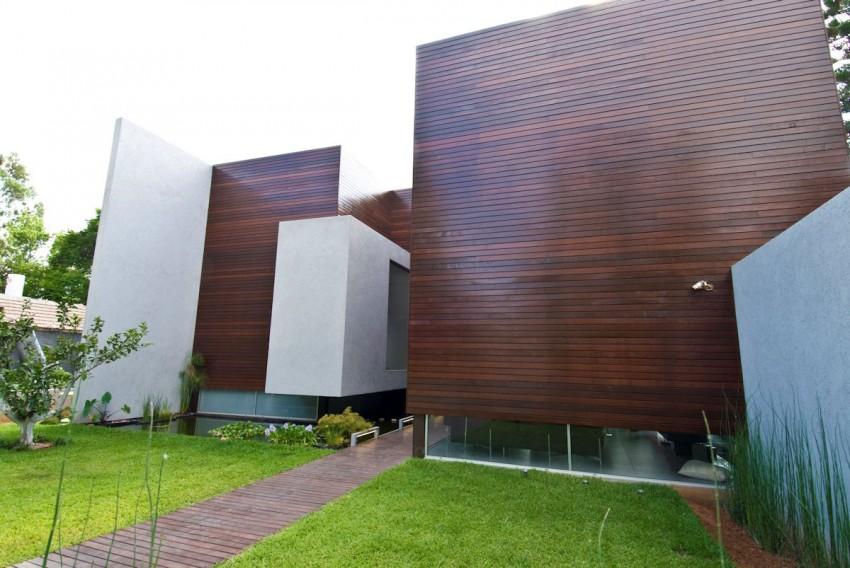 Dosis arquitectura casa de concreto y madera de nestor sandbank - Casas de madera y cemento ...