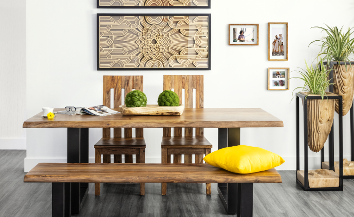 Brown dining room table with wooden bench and wooden chairs.