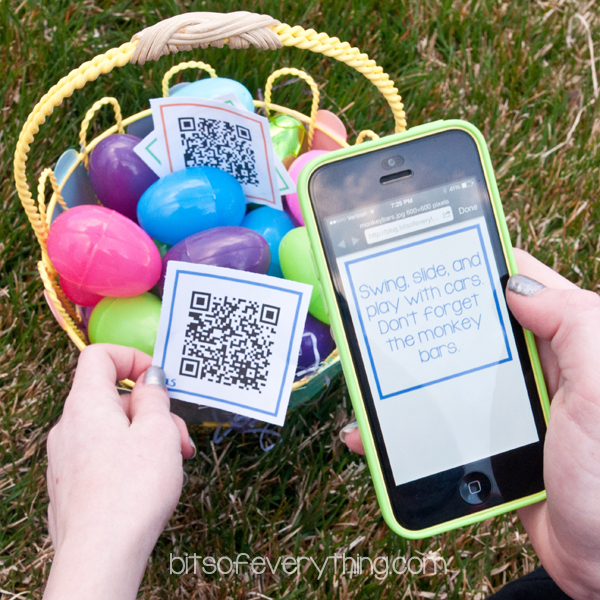 Smartphone scanning QR code that is over an Easter basket filled with colorful plastic eggs.