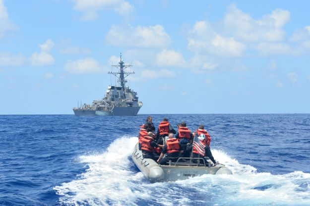 Sailors assigned to the Arleigh Burke-class guided-missile destroyer USS Ross (DDG 71) conduct small boat operations in a rigid-hull inflatable boat on Aug. 3, 2014. US Navy Photo