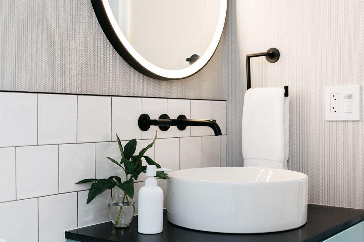Bathroom backsplash with offset white square tile