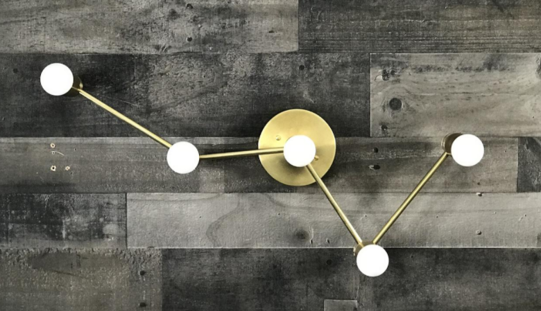 Constellation light fixture work from home gift idea on grey wood wall background