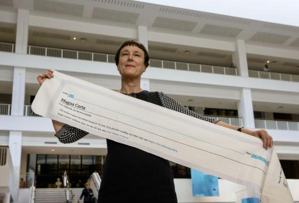 Cornelia Parker With A Completed Section Of Magna Carta (An Embroidery)