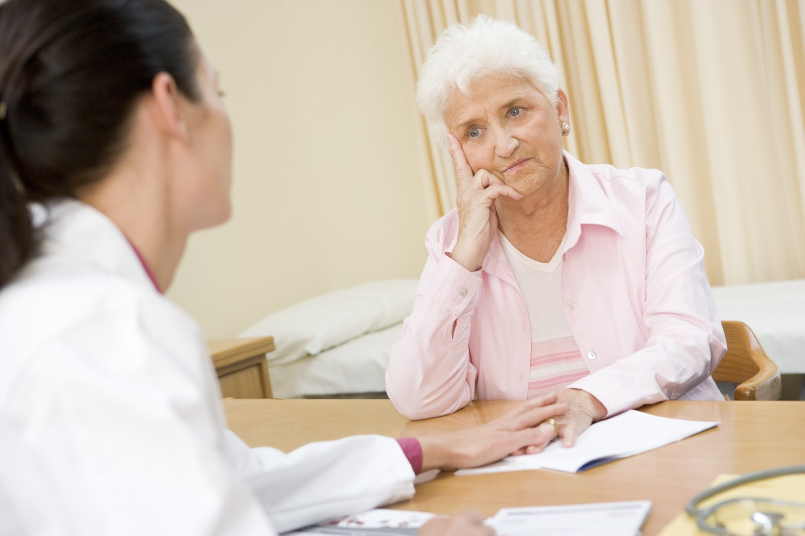 An elderly woman talking to a therapist about her body image
