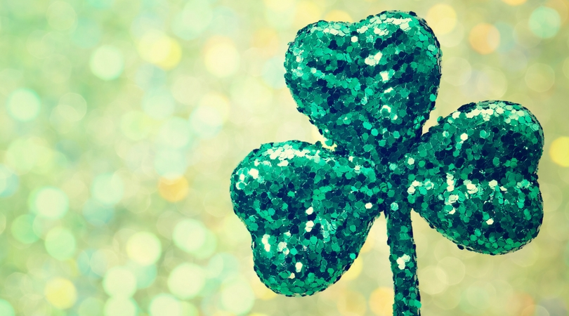 A glittery shamrock on a green background in honor of St. Patrick's day at Cypress River