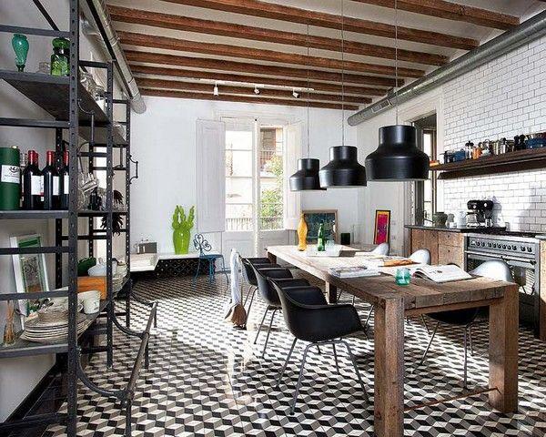 cuisine d'entreprise avec table, étagères et éclairage de style industriel