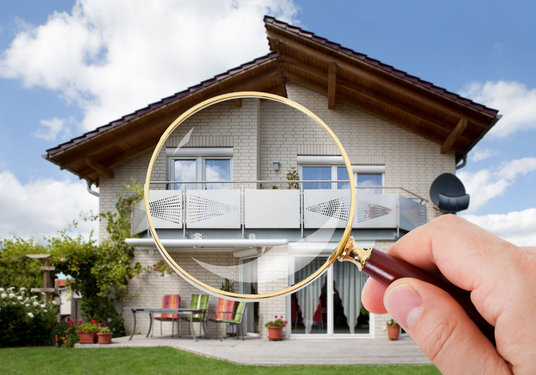 Magnifying glass inspecting a home.