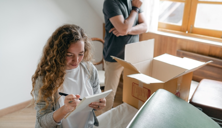 Woman looking at her moving checklist