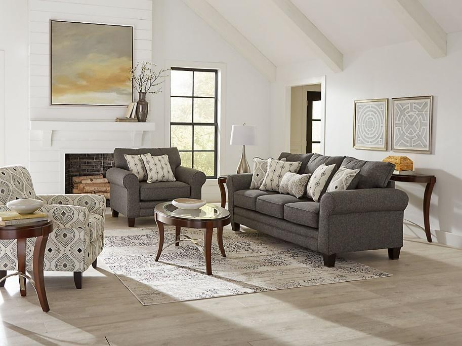 A living room set with a fireplace