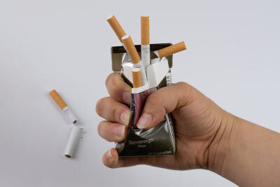 Cigarettes Crushed in Hand