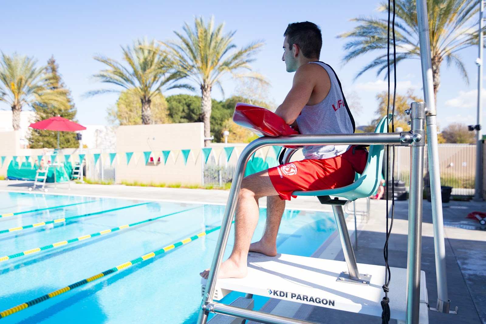 Campus Rec lifeguard on stand overlooking the BRIC pool