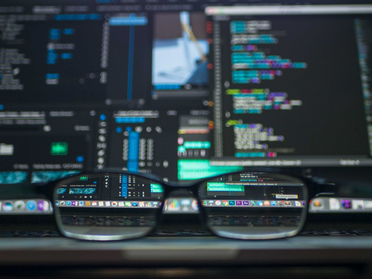 Black Framed Eyeglass on Laptop.