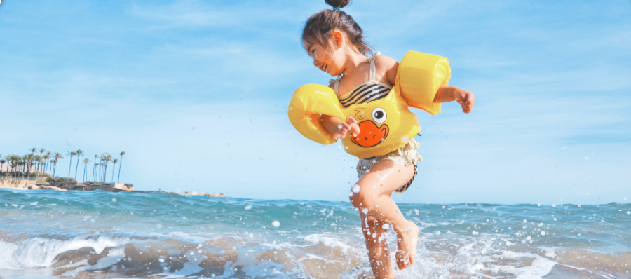 image with girl jumping in water