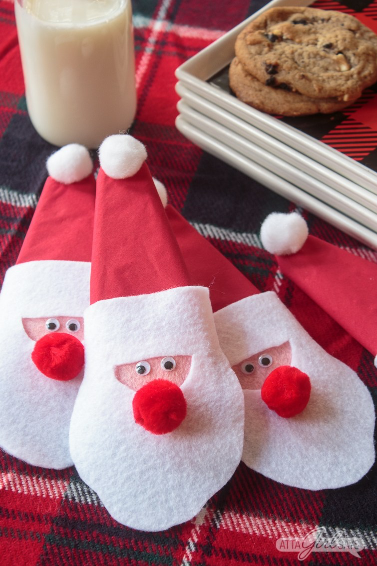napkin rings made from felt that look like santa claus