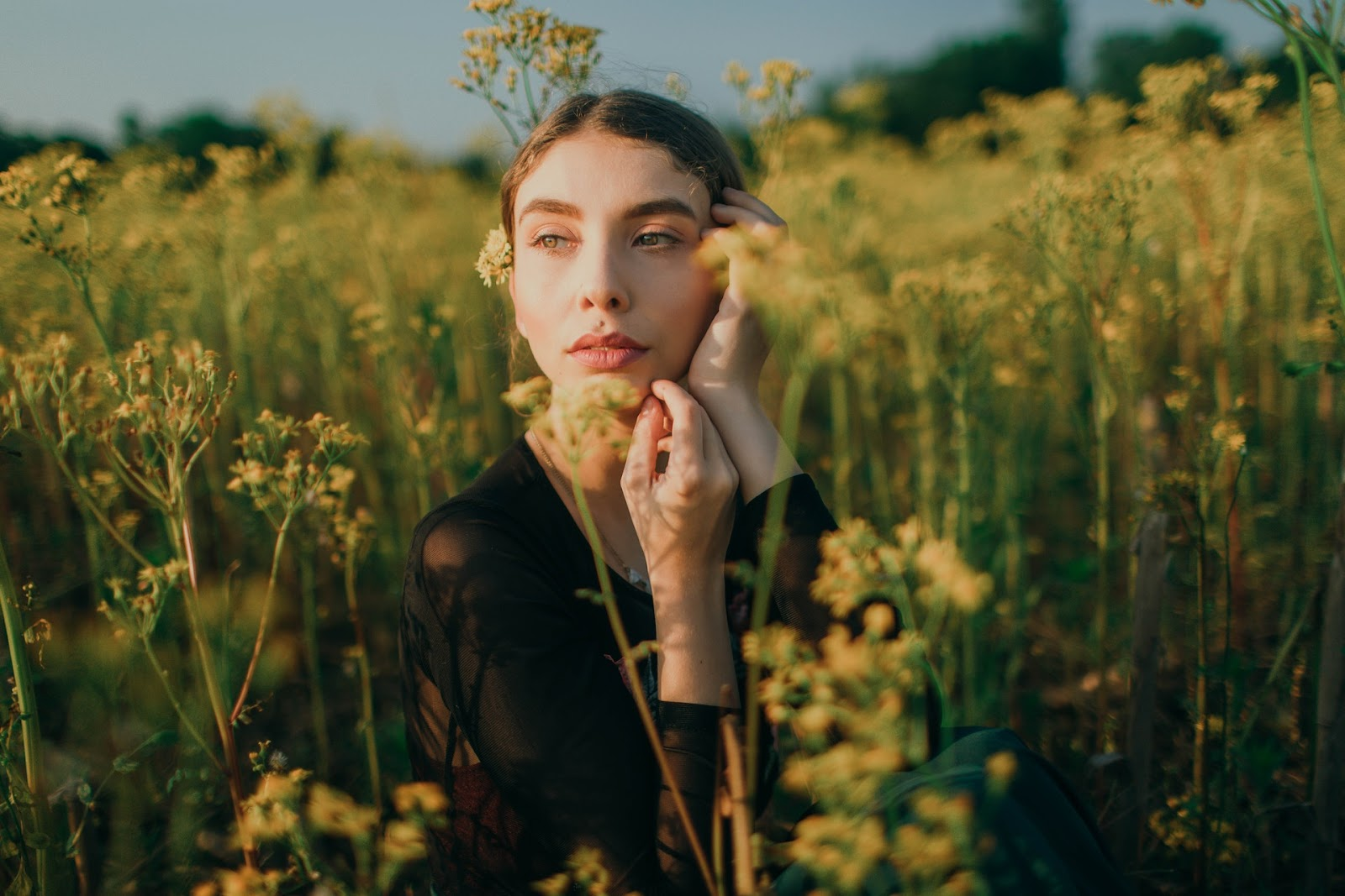 woman in a field of flowers portrait photography