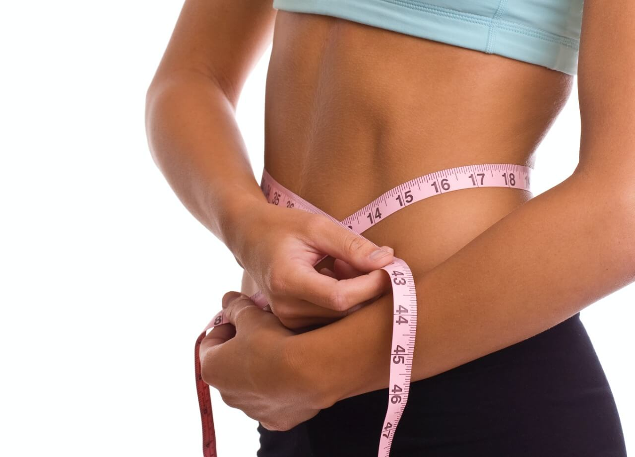 Image of a woman measuring body weight