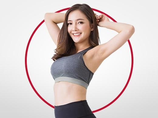 Happy young woman with dark hair wearing tank top, stretching and smiling after Canesten ringworm treatment