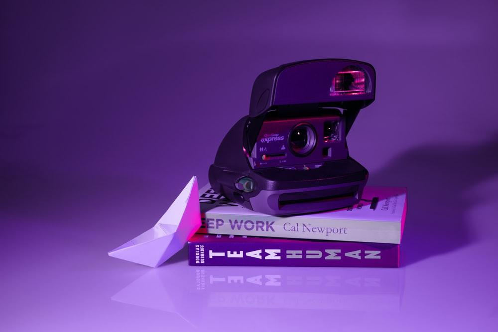 camera on top of books
