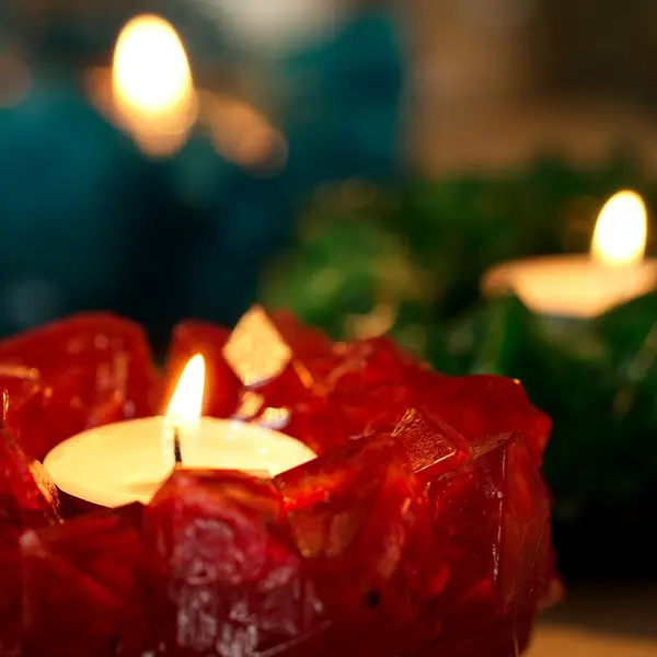 Red crystal candle burning