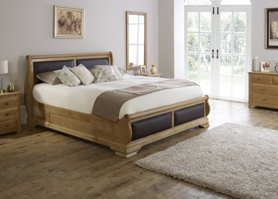 The Amalfi Sleigh Bed in Natural Oak with Black leather