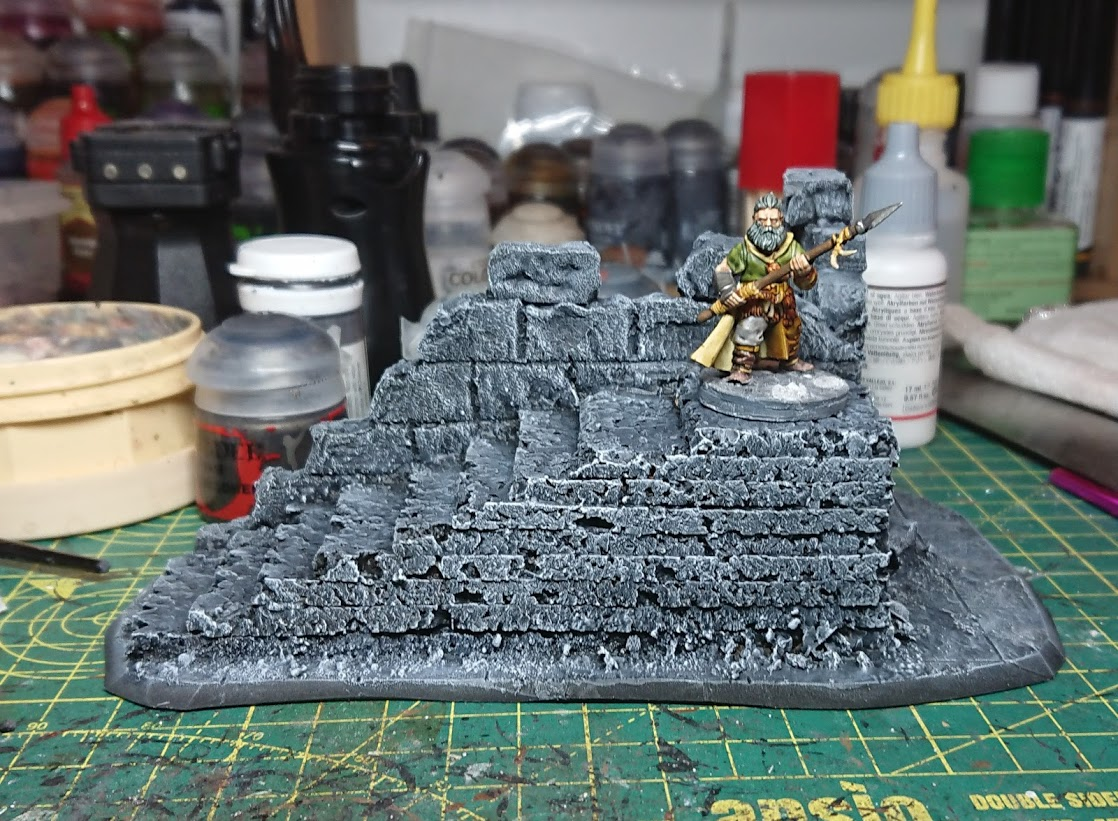 A Frostgrave barbarian on a painted terrain piece of a ruin.