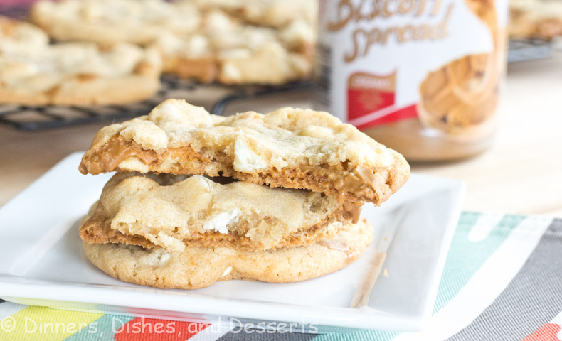 Biscoff stuffed white chocolate cookies on a white plate