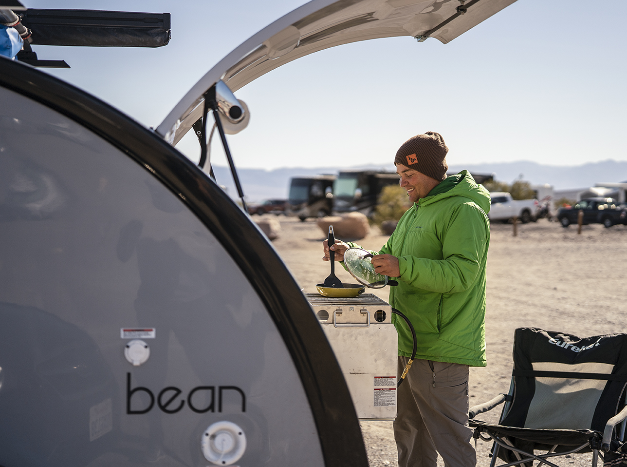 Cooking in the outdoor galley of the Mean Bean teardrop camper.