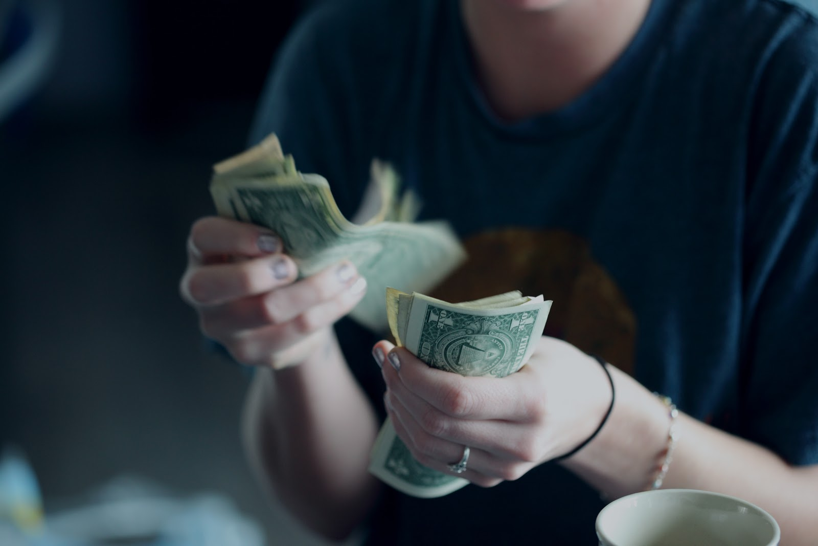women counting her cash