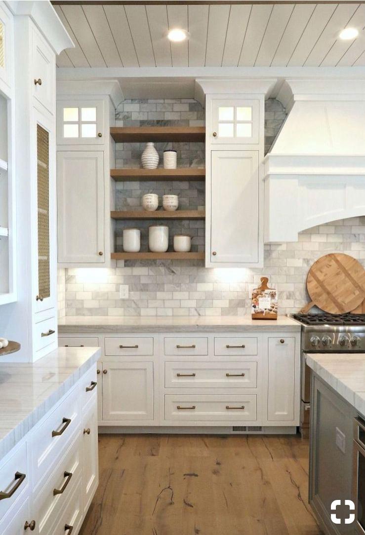 kitchen featuring white shaker cabinets, light wood floors, grey subway tile backsplash, open shelving, brass hardware and shiplap ceiling