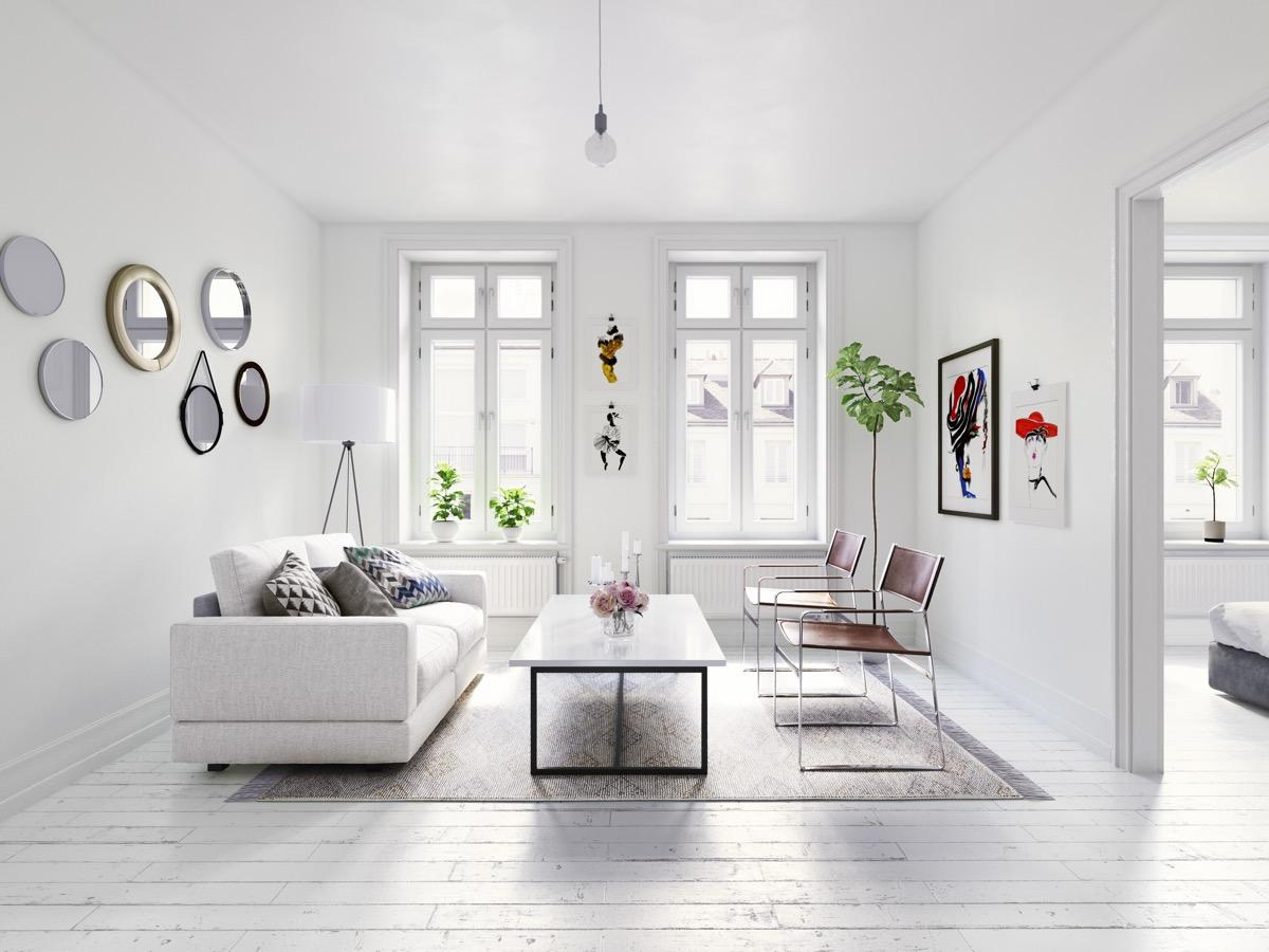 A living room with white furniture  Description automatically generated with low confidence